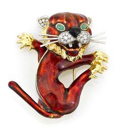A diamond, emerald and enamel lion brooch, Kutchinsky, London,