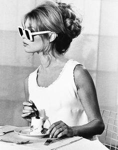 Messy bun, white frames, glasses over hair