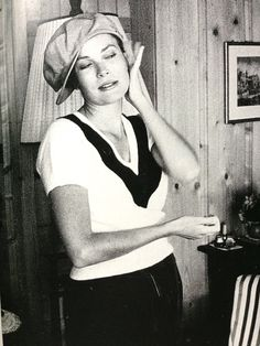 Grace Kelly tries on one of Prince Rainier's hats and strikes a sultry pose in 1957, taken by Howell Conant.