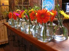 Patron bottles for simple wedding centerpieces~ Stems Flower Shop