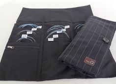 Della Q's Esquire Collection offers their popular needle cases in a clean chalk stripe cotton fabric. Cases include labels for needle size and coordinating button and string closure. This Tri-Fold Cir