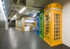 Find the man in the phone booth creepley peaking through the windows | Iponweb Company Office Interior in Moscow, Russia