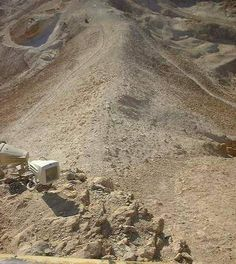 Close up view of the base of the former Roman ramp leading up to the mountain fortress of Masada, Israel.