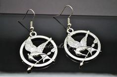 Silver hunger games mockingjay earrings,the hunger game logo piercing earrings EHG07S. $2.99, via Etsy.