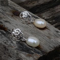 Pure silver studs with pearls attached and are good on girls #silver #silverjewellery #pearls #pearljewellery #zirconiastones #studs #silverstuds #beautifulearrings #silverstore #pearlearrings #silverornaments #pearlstuds #earringswithpearls #stonedearrings #earringswithstone