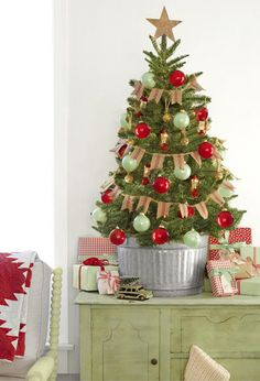 37 christmas tree decorating ideas how to decorate a christmas tree country living - Mini Live Christmas Trees