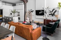 "[Minus the ""tusk art"" on the coffee table] - Industrial Style Loft in the Heart of New York City"