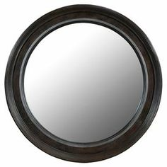 """Mink-finished wall mirror with a grooved frame.  Product: Wall mirrorConstruction Material: Wood and mirrored glassColor: MinkFeatures: Beveled glassDimensions: 41"""" Diameter x 2"""" D"""
