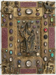 Copper-gilt, cabochons, porphyry German book cover, 19th or early 20th century (mid-13th century style), depicting the Virgin and Child and the Four Living Creatures, at the Metropolitan Museum of Art -- Accession Number: 17.190.405