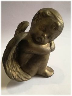 Ceramic Sleeping Angel Gilt removed on small areas while cleaning. Black Marks - especially on wings Dimensions +/-: 135 x 130 x 95 (mm) : x x (inch) Weight +/-: 321 g : ounces Garden Sculpture, Wings, Arts And Crafts, Sleep, Angel, Cleaning, Ceramics, Ornaments, Outdoor Decor