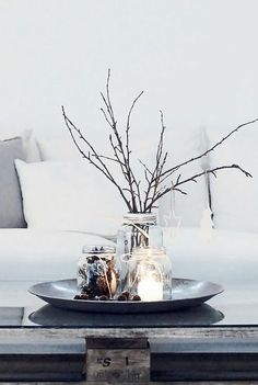 Jars, sticks and candles--simple, spare decor for late winter.