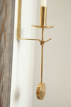 Pair of Candle Sconces by Pierre Forsell for Skultuna | From a unique collection of antique and modern candleholders and candelabra at http://www.1stdibs.com/furniture/lighting/candleholders-candelabra/