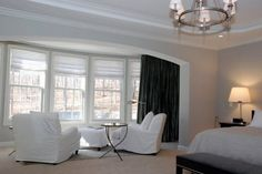 Forest green silk drapery panels make a bold statement in this stark white bedroom. Silk Drapes, Drapery Panels, Curtains, All White Bedroom, Great Rooms, Window Treatments, Family Room, Windows, Green Silk