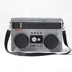 The Classic 80′s Boombox bag takes you back, back to when you wanted a cabbage patch kid, back to the saturday mornings you spent countless hours watching Teenage Mutant Ninja Turtles , back to Rebook Pumps and characters like Radio Raheem. It's almost like a time machine, but we're all aware the 80′s are long gone. This bag is a simple reminder of how things were done and how far we've come.  Features 1 interior zipper closure, 1 main compartment, and 2 exterior pockets.   Material: ...
