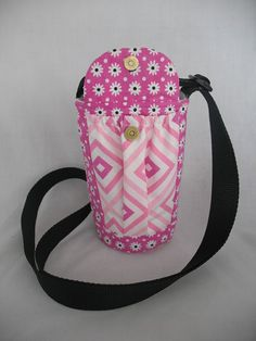 This insulated water bottle sling has 2 elastic pockets for cell phones, keys etc. One pocket has a flap with a heavy duty magnetic snap. The bag is insulated with insul-brite to keep your beverage cold. The strap is made from polypropylene webbing for wear with 2 D-rings and a tri-slider for adjusting and is about 4 long. This bag would be good for flee markets,walks or anyplace you dont want to carry a purse. White interior. Button may very. Last 2 pictures show sizes.