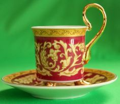 Very nice vintage porcelain coffee cup and saucer set (not signed)