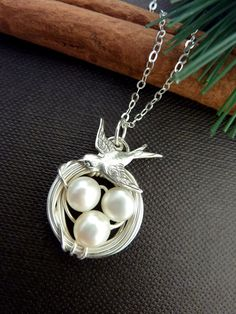 This ORIGINAL VERSION design necklace features a hand wired bird nest with 3 AAA white button fresh water pearls with silver wire, with a very cute silver plated sparrow bird, hanging on top, in a sterling silver chain, finished with sterling silver clasp.  The necklace measures about 17 inches long.  If you need more initial leaf or disc, here are the listings: Listing: http://www.etsy.com/listing/86256906/custom-initial-add-and-pick-up-2-leaf-or Listing…