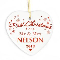 First Christmas Ceramic Heart Decoration Personalise this stylish Our First Christmas Ceramic Heart Decoration with names upto 15 characters and a