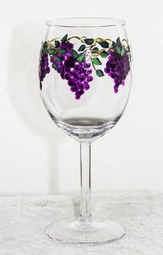 These hand painted wine glasses hold 10 oz. The price is for a pair. The shape says red wine, of course, but it can be used for the beverage of your choice. Each glass is created free hand and no two are the same. They are individually initialed, signifying they are not mass