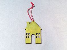 Festive Ornament House, Bright Green with Yellow String. Featured in 2014's November issue of HGTV™ magazine.