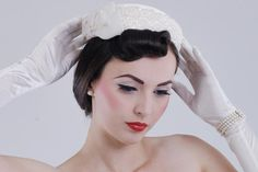Rolled bangs and a vintage wedding hat