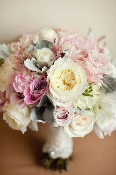 Pretty is an understatement!  The soft colors are absolutely stunning.  Perfect example of a full traditional hand tied bouquet.  This could also take substitution of richer colors and would be perfect for a late summer or fall wedding.  Love those full David Austin roses!
