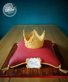 """Cushion cake with a fondant crown and birthday plaque. I wanted to keep the overall look a bit more 'manly' rather than a cake which wouldn't look out of place if it had a tiara on it.  Cake was carved from 14"""" square sponges and sits on a 18"""" square cake drum. It was HEAVY. Thankfully Mr HLB took charge of photos and delivery. He also did the fancy writing on the plaque. Teamwork!"""