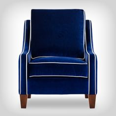 Blue velvet armchair with white piping