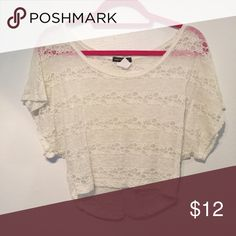 Small Body Central Lace Tee Super adorable ivory lace shirt from Body Central. It is see-through so it's really cute with a bralette underneath! In good condition! Offers are always welcome through the offer button. Thanks for looking :) Body Central Tops Tees - Short Sleeve