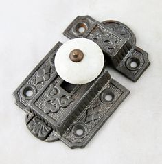 Cabinet latch with porcelain knob by oldegoodthings on Etsy