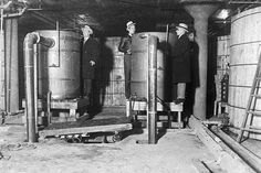 The largest distillery ever uncovered in Detroit was raided and prohibition officers are seen inspecting tanks and vats in one part of the plant, on Jan. Each of these vats have a capacity of gallons and there were thirteen on this floor alone. Mystery Dinner Theater, Dinner Theatre, End Of Prohibition, Michigan, History Of Wine, Detroit History, Today In History, Past Tense, Image Of The Day