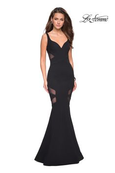 This La Femme 27104 black prom gown features a mermaid silhouette in jersey, with slim straps edging the curved V-neckline and the cutout scoop back. Illusion side cutouts adorn the bodice and thighs, offset with a brush train. Grad Dresses Long, Prom Dresses For Teens, Unique Prom Dresses, 15 Dresses, Casual Dresses, Formal Dresses, Dresser, Prom Dress Stores, Designer Prom Dresses