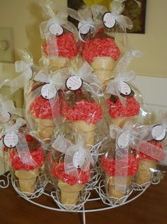 rice crispy ice cream cones for favors in a cupcake display