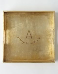 Monogrammed tray in gold