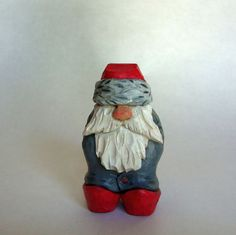 Nisse Woodcarving, Santa, Tomte, Kabouter Original Hand Carved sculpture, Collectable Gift, 5th Anniversary Gift  This carving is of a small Nisse or his Swedish cousin the Tomte. He is carved with his hat pulled over his eyes. Wonder what he sees. The Nisse is the Christmas gift giver of Norway and Denmark. He has been part of the Danish folklore for centuries. Kabouter is the Dutch/Afrikaans word for gnome or leprechaun. In folklore, the Dutch Kabouters are akin to the Irish Leprechaun…