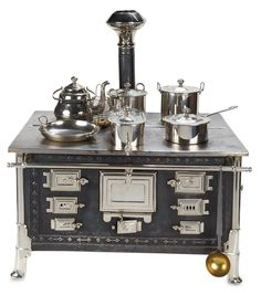 Grand German Tin and Nickel Toy Stove with Original Utensils by Maerklin.
