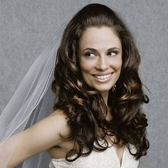 Curly flowing long hair on sides and back, and pulled back on top.    Referenced by WHW1.com: Business Hosting - Affordable, Reliable, Fast, Easy, Advanced, and Complete.©