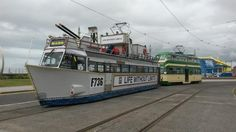 Blackpool Trams. Frigate 736 sharing the outer loop at Pleasure Beach with Balloon 717