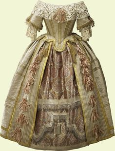 Commissioned by Queen Victoria for the Stuart Ball, 1851, this dress was designed by Eugène Louis Lami (1800-90).  The most glamorous of all this costume was inspired by the court of Charles II. The rich brocade of the underskirt was woven in Benares. The lace of the berthe is a copy of seventeenth-century Venetian raised-point needle lace, probably made in Ireland and perhaps acquired at the Great Exhibition.