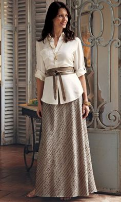 very elegant- 3/4 sleeves and long skirt- even more simply modest without the jewelry!