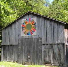 Quilt design on a Kentucky barn. Great contrast between the old wood and the bright colors.