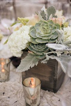 I love this mix of flowers and succulents. I plan to have candles around the box like you see in the picture as well as some loose succulents I'll be providing to set on the table.