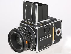Hasselblad 503CW  --  This Hasselblad 503CW Millennium chrome camera comes with special gold colored darkslide and magazine slide on the filmback. This set comes with CFE 2.8/80mm (#8882408), A12 (#30SS17634), matching box, body cap, leather strap and papers, the lens with box, instruction manual and both caps.