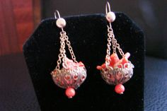 I have had these coral chandelier filigree drops for many years and decided to add vintage gold earwires and present them for sale.  While it is indeed a marriage, the earr... #vintagejewelry #teamlove