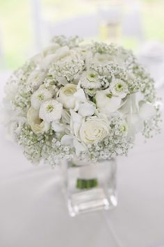 White ranunculus and baby's breath centerpiece www.significanteventsoftexas.com