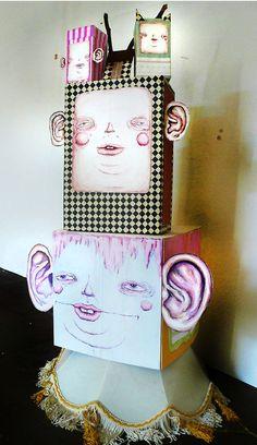 tower of block heads and aliens.    Art show at Islington Mill Studios, in Salford, England.  (www.danielleardenomalley.net)