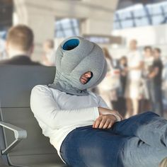 The Power Nap Head Pillow - This is the head-enveloping pillow that blocks out noise and light to create a private zone for catching a quick power nap. - Hammacher Schlemmer