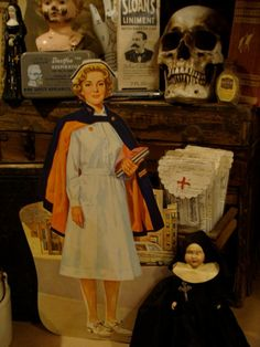 Rare Antique Medical Vintage Nurse Classroom by reginasstudio  WHAT'S WITH THE WEIRD NUN DOLL ON THE BOTTOM?