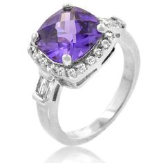 White Gold Rhodium Bonded Amethyst Fashion Ring Accented with Clear CZ and Filigree Finish in Silvertone. Violaceous Ring is embellished with a cushion cut Amethyst CZ on top and clear CZ accents along side. White Gold Rhodium Bond is achieved using an electroplating process that coats the item with heavy layers of rhodium a close cousin of platinum that costs three times as much which gives our jewelry a platinum luster.