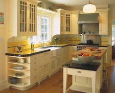 Mahoney Architects & Interiors: A gourmet retro kitchen; LOVE backsplash;  retro feel
